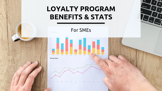 10 Loyalty Program Benefits & Stats for SMEs [2020 Ultimate Guide] - A person cutting a piece of paper - Business